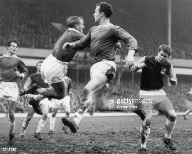 West Ham insideright Geoff Hurst grimaces as Birmingham City goalkeeper John Schofield punches a cross clear during the 3rd round of the FA Cup match...