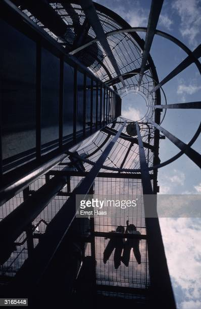 A wormseyeview of construction workers on a nearly completed building in New York