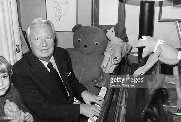 Edward Heath British Conservative politician and prime minister playing the piano to the amusement of Kermit the Frog and Paddington Bear
