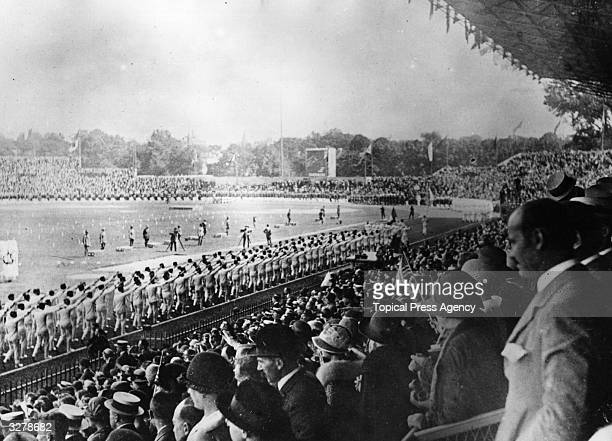 An interior view of the opening ceremony at Colombes Stadium during the Paris Olympics