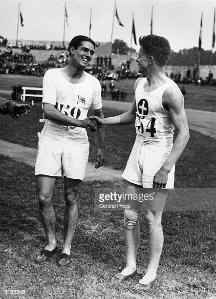 British athlete Douglas Lowe receives a congratulatory handshake from the runnerup Switzerland's Paul Martin after winning the Olympic 800 metres at...
