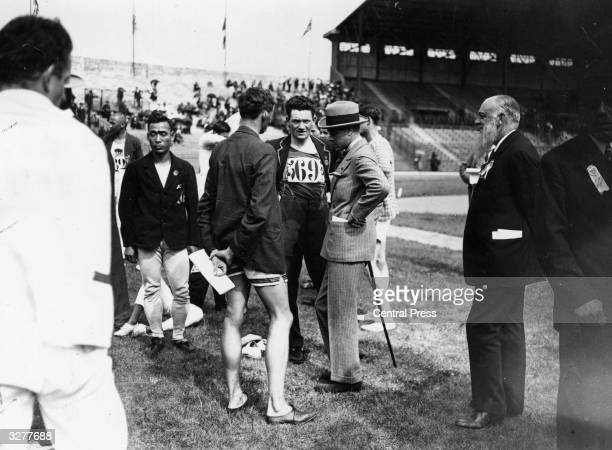 The Prince of Wales later Edward VIII talking to S Lavan a competitor for Ireland during the Olympic Games at Colombes Stadium in Paris