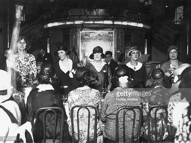 American born Viscountess Astor MP the principal guest at a lunch in the Cafe de Paris organised for the National Council of Girls Clubs is standing...
