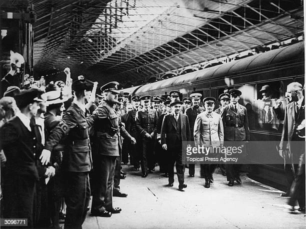 Russian commander Lt General Golikov Deputy Chief of General Staff and leader of the mission with Mr Maisky Soviet Ambassador being greeted at Euston...