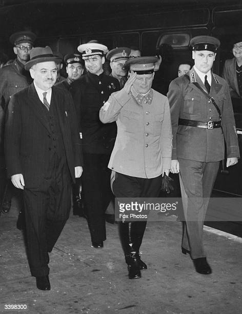 Soviet General Filipp Ivanovich Golikov with Soviet ambassador Ivan Maisky and other members of the Soviet military who are in London for talks on...