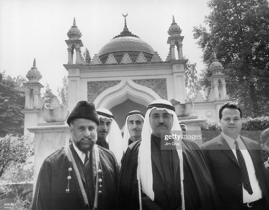 Sheikh Khalid bin Muhammad Al Qasimi, Ruler of Sharjah, with the Imam Misri (left) in front of the Shah Jehan Mosque in Woking, Surrey.