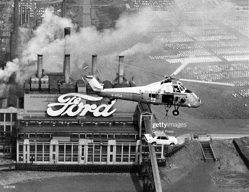 In a publicity exercise, Ford's one millionth export Cortina car is airlifted by a Westland Wessex helicopter over Ford's Dagenham plant on its way to Belgium, where its new owner is waiting with the keys.
