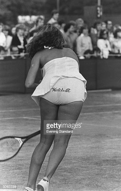 Chris Evert of the USA serves so powerfully that her skirt flies up revealing an amusing pair of knickers