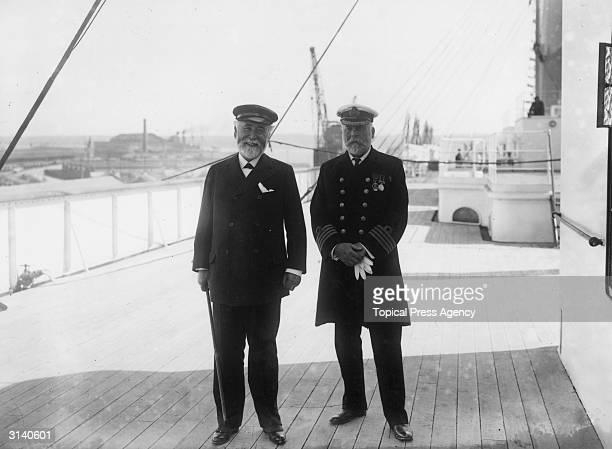 Captain John Smith and Lord James Pirrie Chairman of the Harland Wolff Shipyard on the deck of the White Star Liner 'Olympic' Captain Smith later...