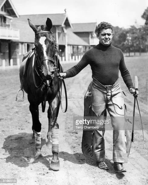 At Hurlingham, Mr Van Brunt an American 'stick and ball' man who works for a British polo player is wearing cowboy's chaps as he leads out one of the...