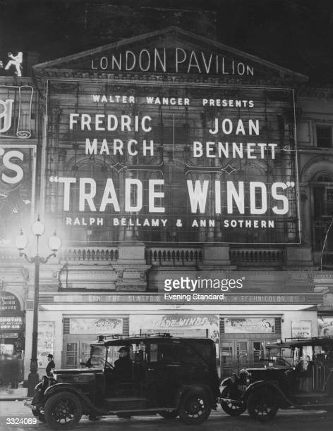 The facade of the London Pavilion advertising the film 'Trade Winds' starring Fredric March Joan Bennett Ralph Bellamy and Ann Sothern
