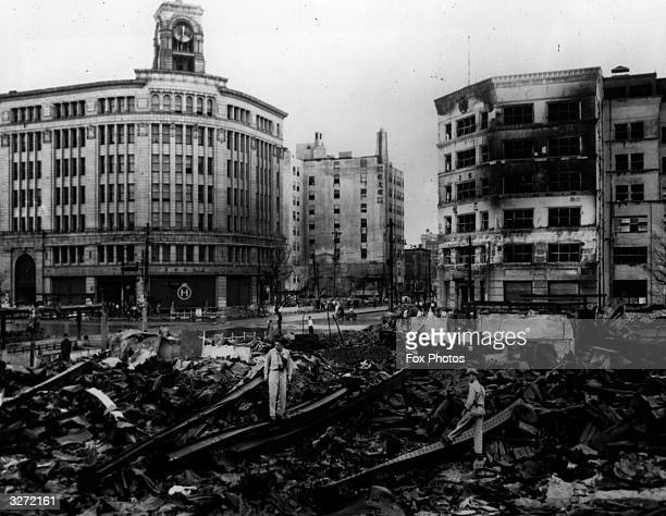 US soldiers examine the results of a B29 Superfortress bomb run on the streets of the Ginza district Tokyo Bombings by American B 29 super fortresses...