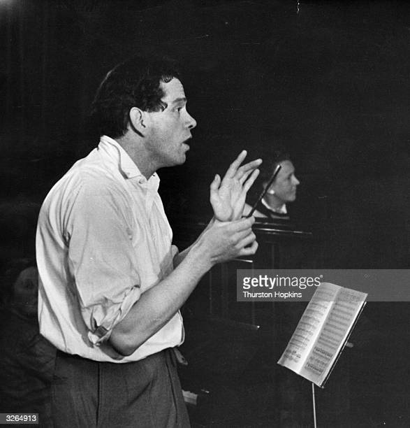 Conductor Edward Renton from the English Opera Group rehearses the chorus of the Welsh National Opera Original Publication Picture Post 5316 Wales...