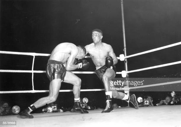 British boxer Randolph Turpin lands a right on Charles Humez of France on his way to beating him for the world middleweight title at White City...