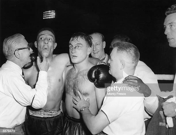 British boxer Randolph Turpin puts his arm around Charles Humez of France after beating him for the world middleweight title at White City Stadium...