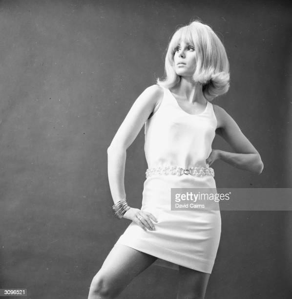 English actress Joanna Lumley modelling a dress