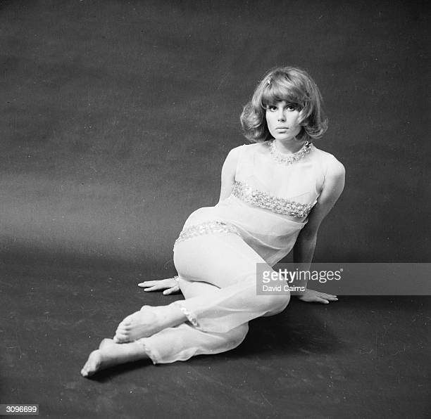 English actress Joanna Lumley modelling a trouser suit