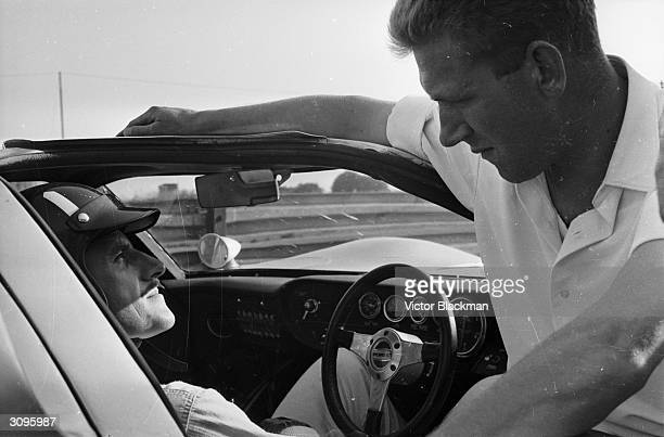 Graham Hill, British racing driver, behind the wheel of a Ford GT during the 166 mph Le Mans race at Snetterton in Norfolk.