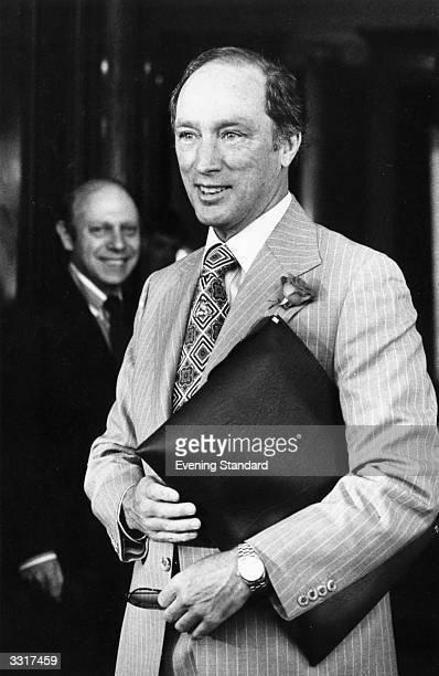 Canadian statesman and prime minister Pierre Trudeau carrying an attachecase