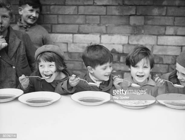 A group of children having a free midday meal at a school in Newport in Gwent Wales The meals have recently been introduced by Monmouthshire...