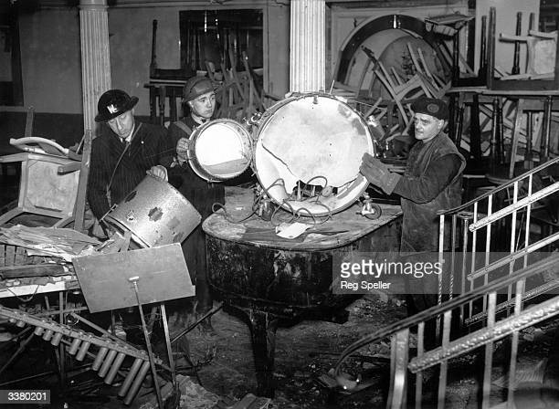 Emergency workers clear out the bombdamaged interior of the Cafe de Paris in London during World War II