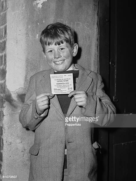 Eight yearold Tottenham Hotspur fan Arthur Everitt of Tottenham London with his ticket to the FA Cup Final between Norwich City and Luton Town...