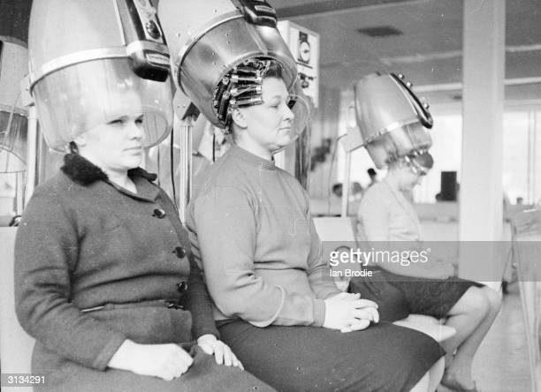 Russian women relax under the dryers in the Moscow Beauty Palace.