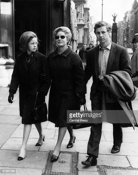 Caitlin Thomas widow of the poet Dylan Thomas with her daughter Aeronwy and son Colm They are on their way to the High Court where she is suing the...