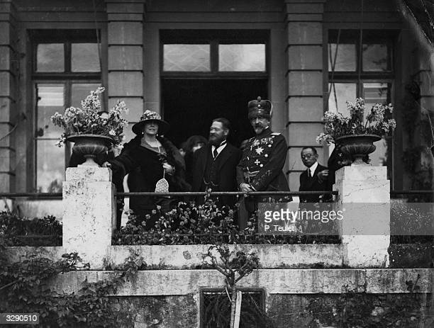 King Ferdinand I and Queen Marie of Romania with A Thomas a director in the office of the League of Nations in Geneva