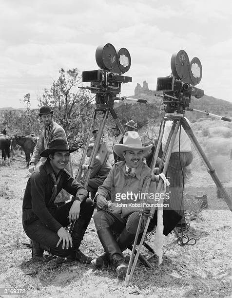 Hollywood director King Vidor on the set of 'Billy the Kid' with his star Johnny Mack Brown