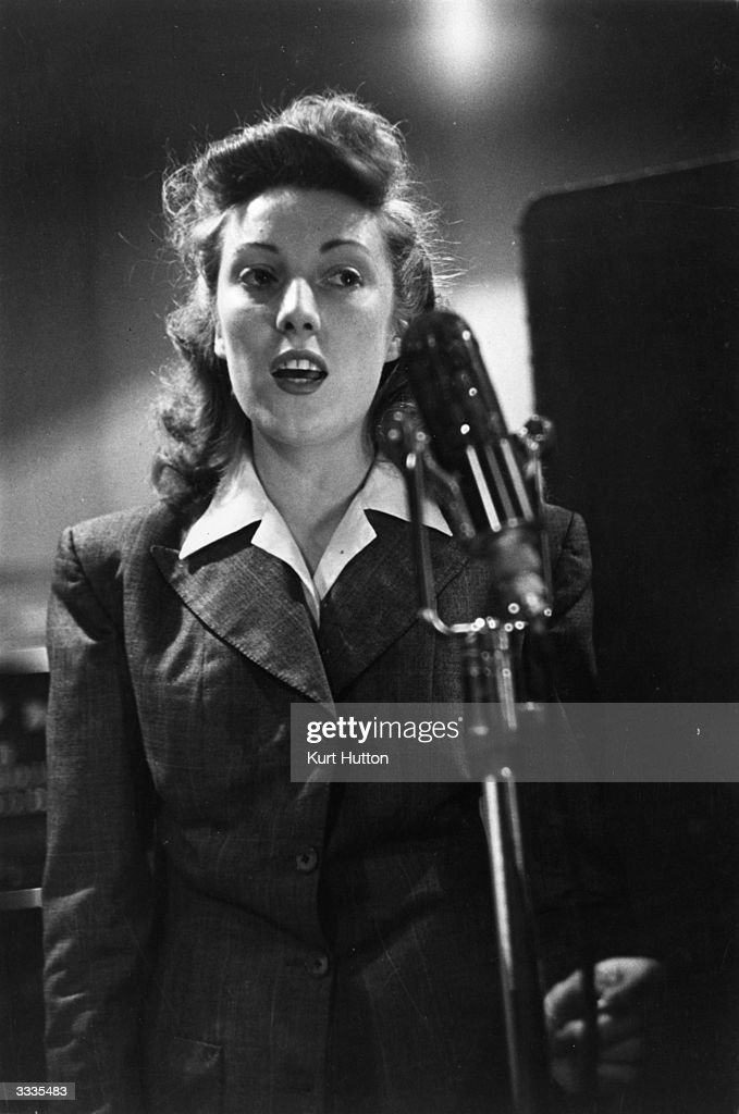 British entertainer Vera Lynn making a broadcast to the country's troops from a radio station. Original Publication: Picture Post - 1992 - Girls Of The Victory Broadcast - pub. 1945