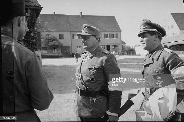 Reich Marshal Hermann Goering wearing the iron cross surrenders as WW II in Europe comes to an end