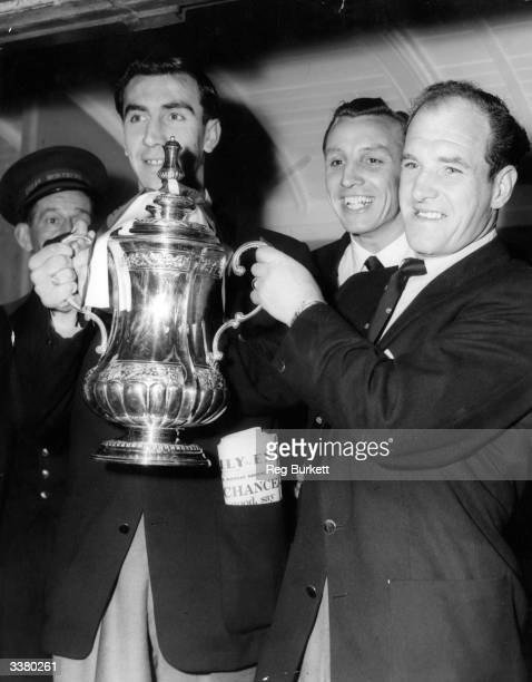 Members of the victorious Newcastle United team with the FA Cup trophy which they won with a 31 victory over Manchester City in the FA Cup final...