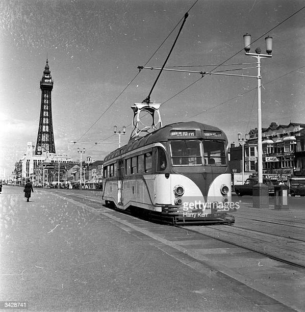 Trams run along the seafront at Blackpool in Lancashire