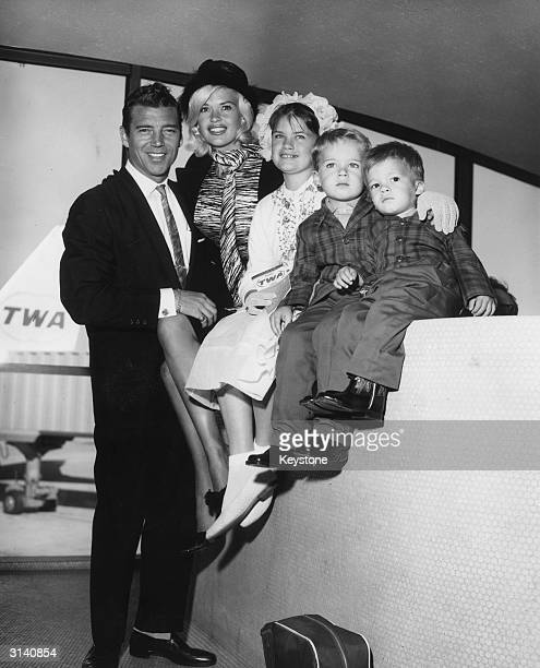 Hollywood sex symbol Jayne Mansfield and her family arrive at New York International Airport from Los Angeles en route to Rome for the filming of...