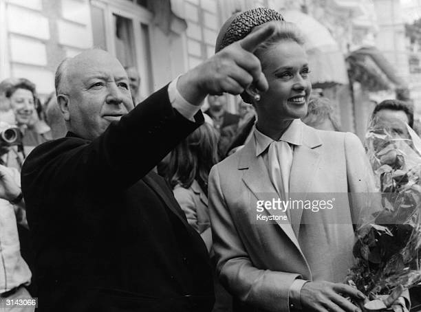 Alfred Hitchcock and American actress Tippi Hedren explore Cannes together after the premiere of his latest thriller 'The Birds' in which she plays...