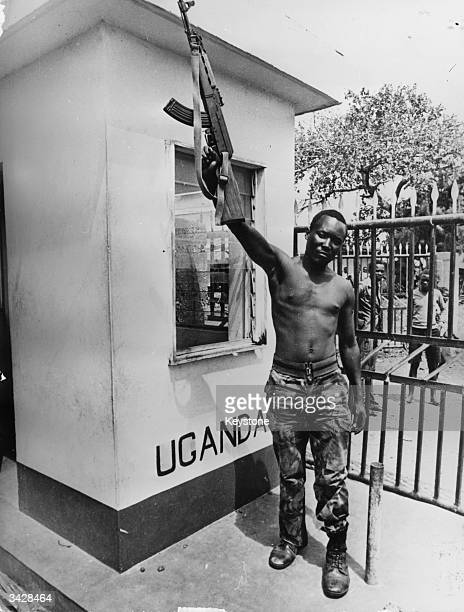 Tanzanian soldier waving his gun in victory on a border post at Busia after its capture from Idi Amin's troops.