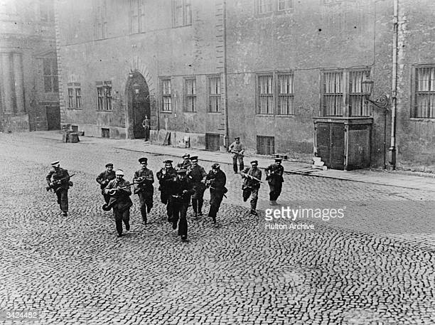 Socialists charging across the Royal Palace yard Berlin forcing their way in during the uprisings which followed Germany's defeat in world War I