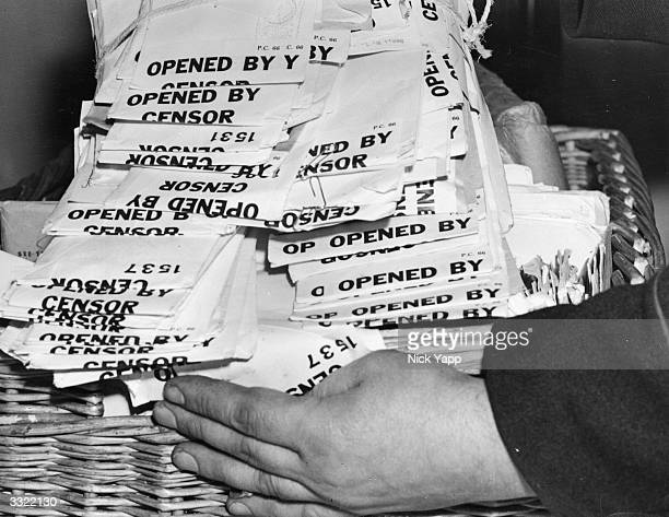 A pile of parcels ready for delivery after being opened and examined by wartime postal censors