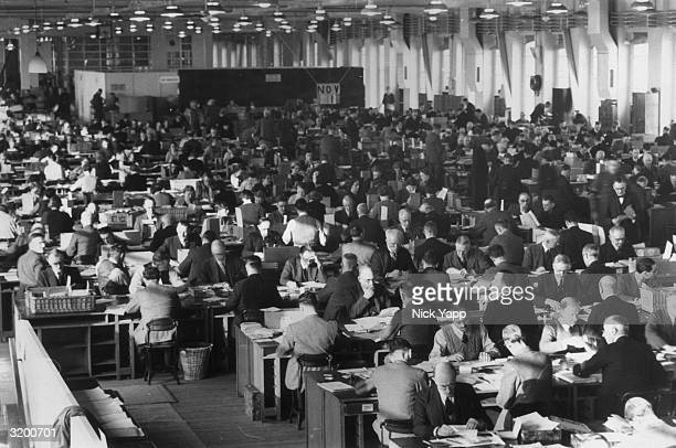 A World War II postal censorship office in the North of England The censor officials have a knowledge of scores of languages between them