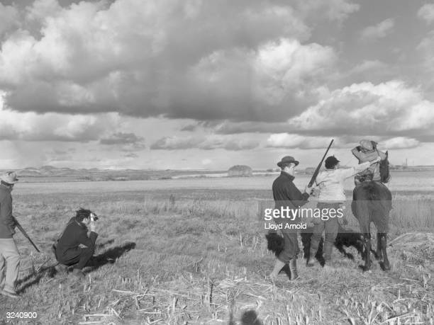 From left to right Taylor Williams Hungarianborn photojournalist Robert Capa Neil Regan American writer Ernest Hemingway and John Meyers during a...