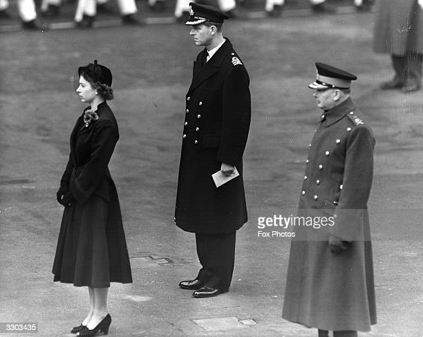 Queen Elizabeth II Prince Philip and the Duke of Gloucester at the official Remembrance Day ceremony