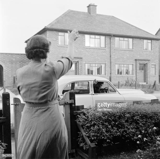 Bernard Bradbury of Hinckley in Leicestershire waves goodbye to his wife as he leaves for work in his new Wolseley Mr Bradbury recently won 15000 in...