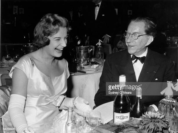 American oil executive multimillionaire and art collector J Paul Getty having dinner with his English solicitor Robina Lund at the Lord Tavener's Ball