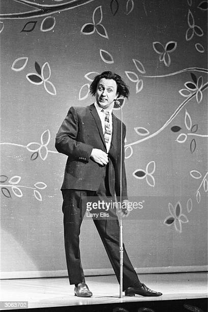 Liverpudlian comedian Ken Dodd does his comic act at a Royal Command Performance