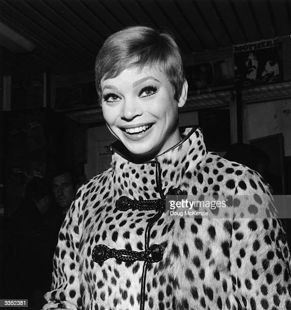 Actress and dancer Juliet Prowse in a leopard skin coat
