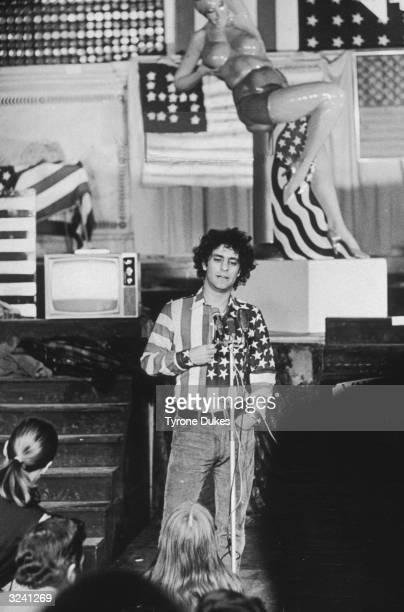 American activist Abbie Hoffman cofounder of the Yippie movement speaks to a crowd while wearing a shirt made from a US flag during an American...