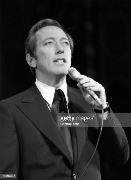 American singer Andy Williams rehearsing at the London Palladium for a Royal Variety Performance