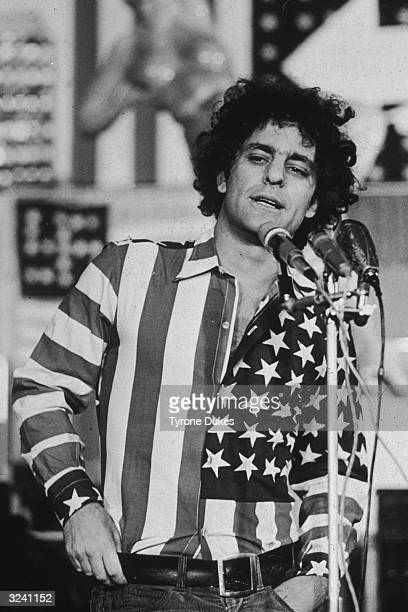 Political activist Abbie Hoffman wearing a shirt made from an American flag speaks at a US flagthemed art show at the Hudson Memorial Church New York...