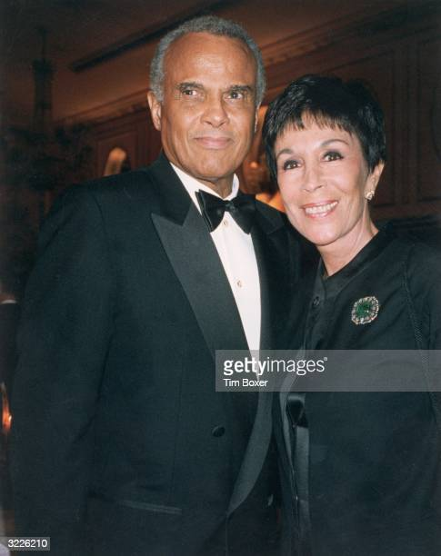 American actor and singer Harry Belafonte poses with his wife Julie Robinson while attending the New York Chapter of Hadassah dinner at the New York...